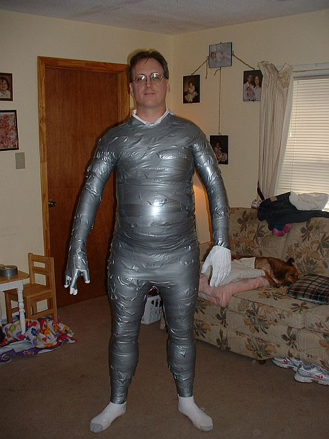 Mummified in silver duct tape - 3 6